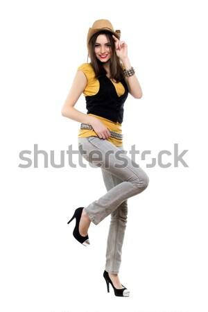 Wdzięczny uśmiechnięty brunetka stwarzające odizolowany Zdjęcia stock © acidgrey