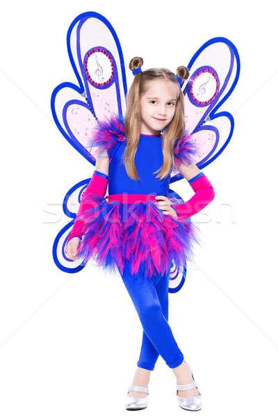 Kecses kislány pózol pillangó ruha izolált Stock fotó © acidgrey