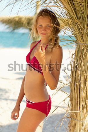 Expressive young woman on a beach Stock photo © acidgrey