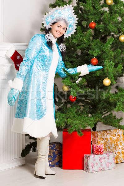 Stock photo: Cheerful snow maiden