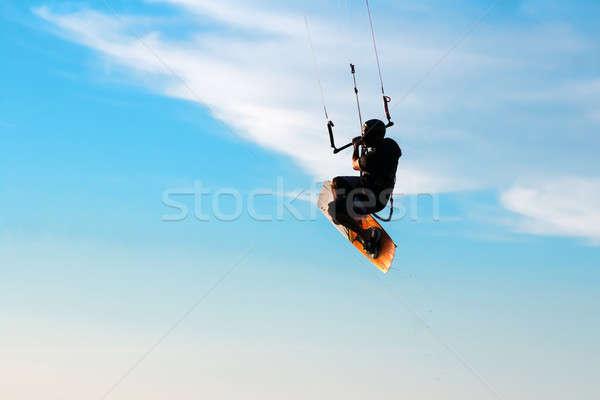 Silhouette of a kitesurfer Stock photo © acidgrey
