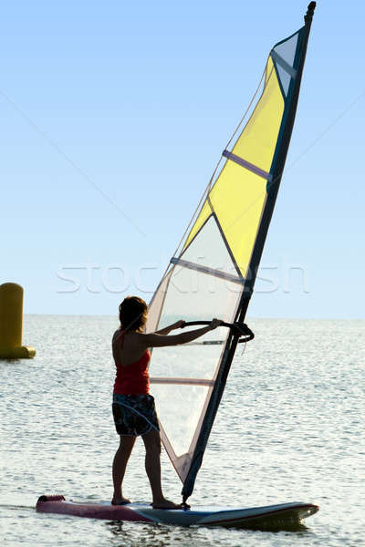 A women on a windsurf on waves Stock photo © acidgrey