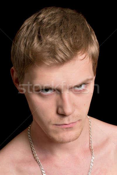 Szeszélyes fiatalember közelkép portré izolált fekete Stock fotó © acidgrey