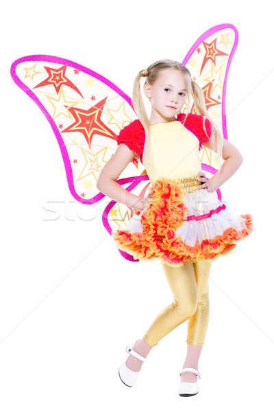 Kecses kicsi szőke lány pózol pillangó Stock fotó © acidgrey