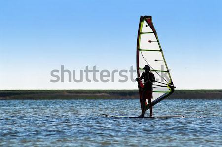 Silhouette of a windsurfer on the sea Stock photo © acidgrey