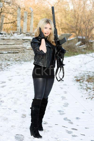 Young beautiful woman with a gun Stock photo © acidgrey