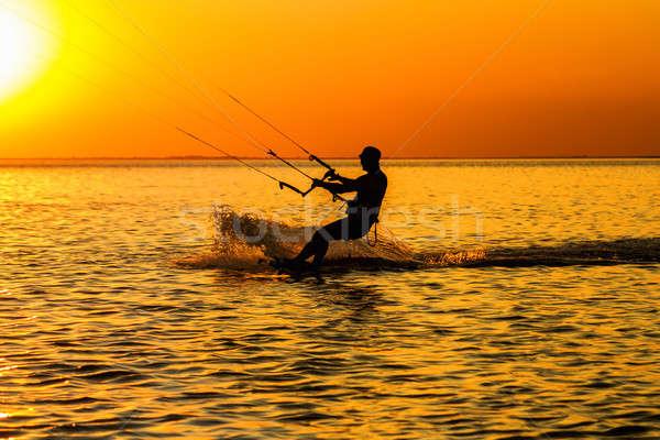 Zdjęcia stock: Sylwetka · żeglarstwo · wygaśnięcia · wody · słońce