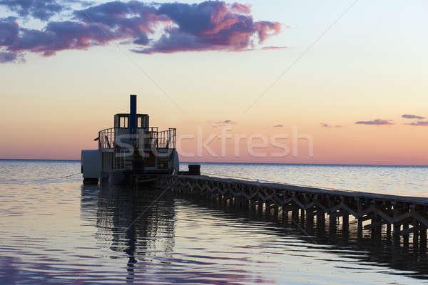 Ferryboat near the pier at sunset Stock photo © acidgrey