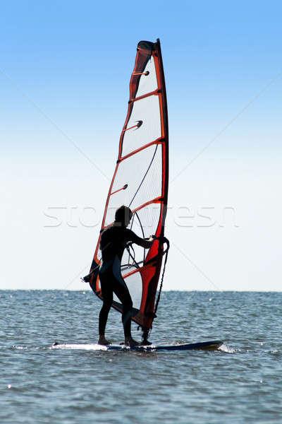 Silhouette of a man windsurfer Stock photo © acidgrey