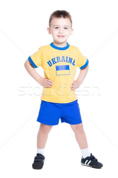 Agradable pequeño nino fútbol uniforme Foto stock © acidgrey