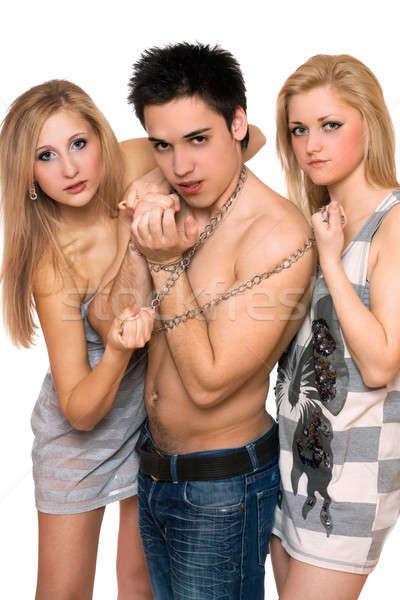 Iki güzel kızlar adam zincirleri kadın Stok fotoğraf © acidgrey