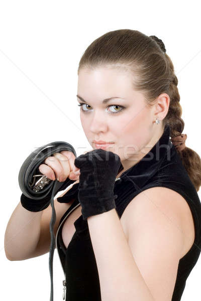 Pretty young angry woman throwing a punch over white Stock photo © acidgrey