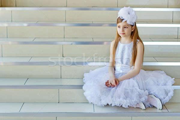 Girl sitting on the steps Stock photo © acidgrey