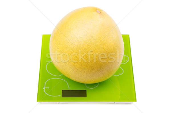 Pomelo fruit on square scales Stock photo © acidgrey