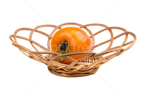 Persimmon fruit in wicker Stock photo © acidgrey