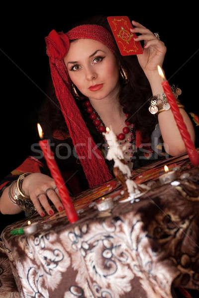 Nő ül kártyák izolált fekete lány Stock fotó © acidgrey