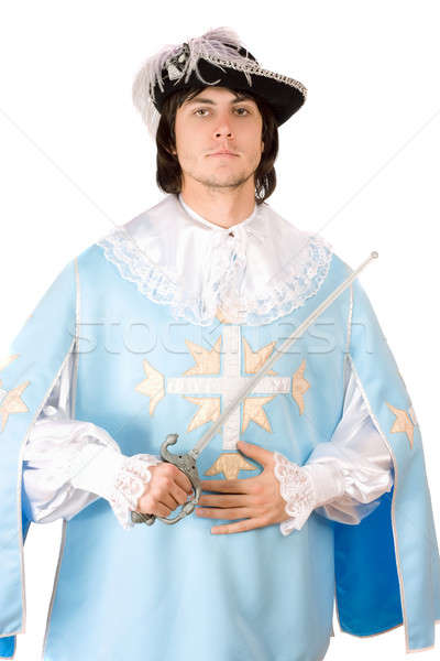 Stock photo: man with a sword dressed as musketeer