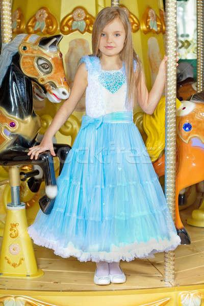 девочку синий платье Постоянный карусель Сток-фото © acidgrey