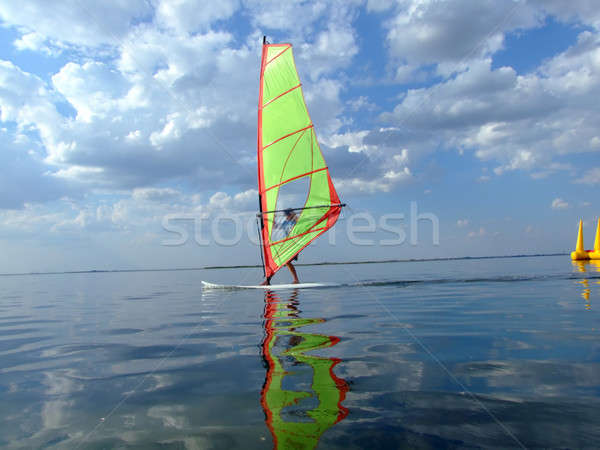 Windsurfer and its reflection in water of a gulf 2 Stock photo © acidgrey