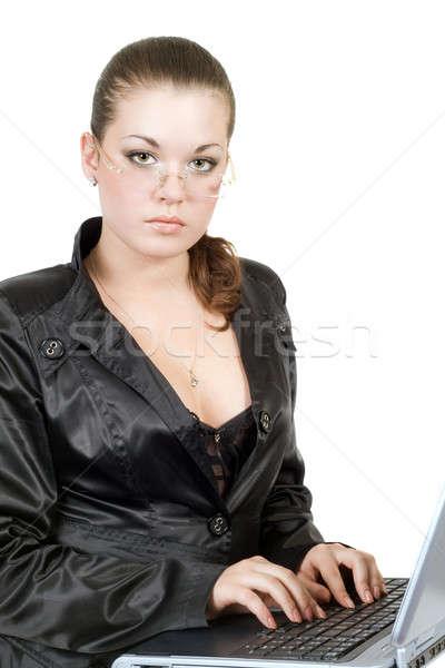 Businesswoman works on the laptop over white Stock photo © acidgrey
