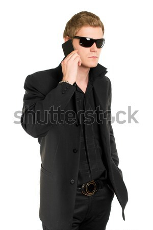 Man in sunglasses with a mobile Stock photo © acidgrey
