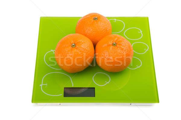 Três doce mandarim balança isolado Foto stock © acidgrey