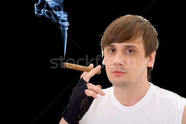 Portrait of the young man with a cigar Stock photo © acidgrey