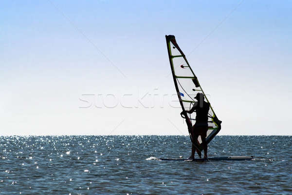 Silhouette of a windsurfer Stock photo © acidgrey