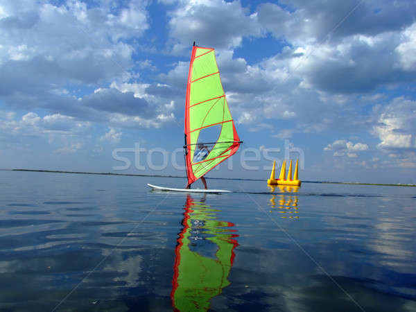 Windsurfer and its reflection in water of a gulf  Stock photo © acidgrey