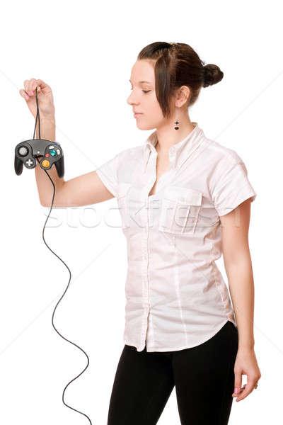 Charming brunette girl with a joystick Stock photo © acidgrey