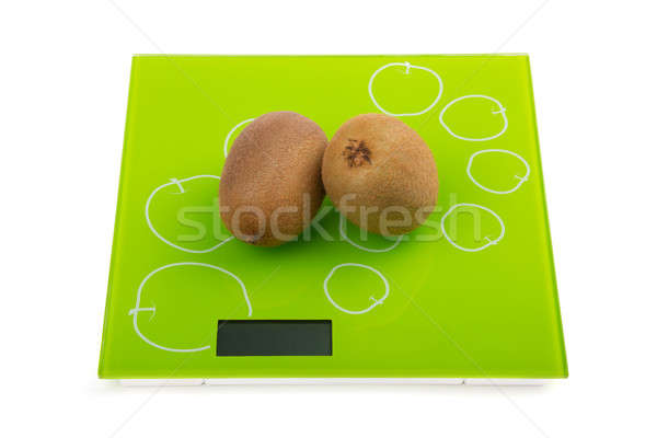 Two kiwi fruit on scales Stock photo © acidgrey