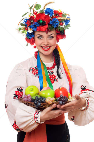 woman in the Ukrainian national clothes with fruit Stock photo © acidgrey
