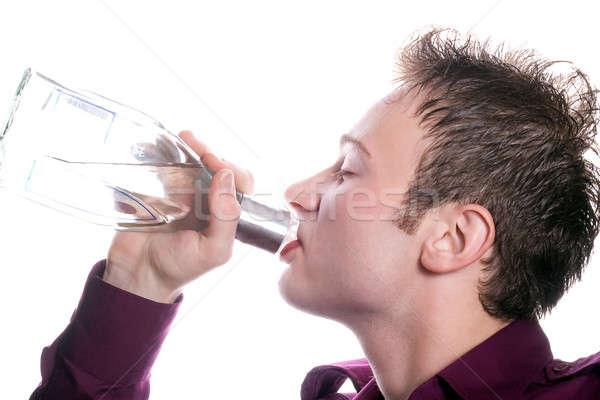 Genç içecekler votka şişe cam içmek Stok fotoğraf © acidgrey