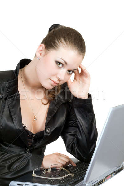 Young businesswoman works on the laptop over white Stock photo © acidgrey
