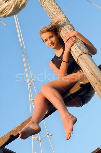 Teen girl hugging the mast Stock photo © acidgrey