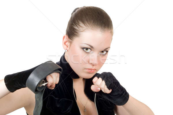 Pretty young angry woman throwing a punch Stock photo © acidgrey