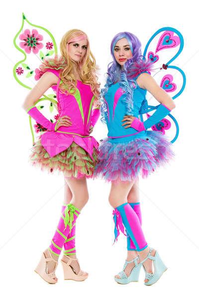 Dos hermosa mujeres posando colorido vestidos Foto stock © acidgrey