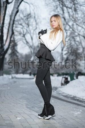 Charming young woman with a gun Stock photo © acidgrey