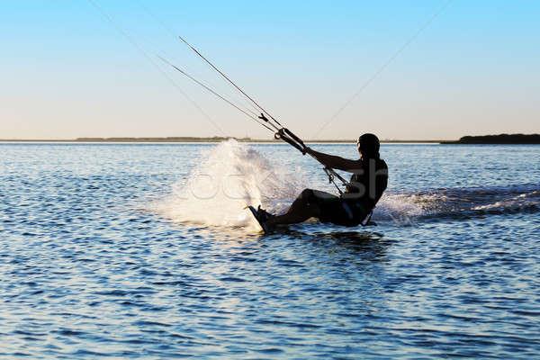Siluet yelkencilik deniz gün batımı su spor Stok fotoğraf © acidgrey