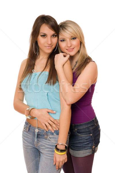 Twee mooie jonge dames geïsoleerd witte Stockfoto © acidgrey