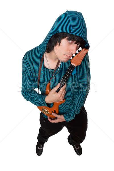 Bizar jonge man weinig gitaar geïsoleerd muziek Stockfoto © acidgrey