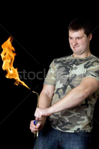 őrült fiatalember benzin zseblámpa kezek férfi Stock fotó © acidgrey