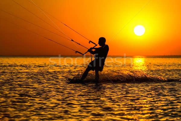 Siluet yelkencilik akşam su güneş spor Stok fotoğraf © acidgrey