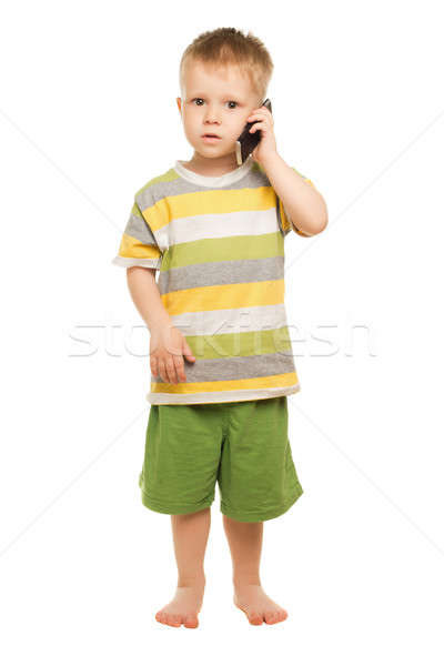 Kicsi fiú rövidnadrág póló pózol mobiltelefon Stock fotó © acidgrey