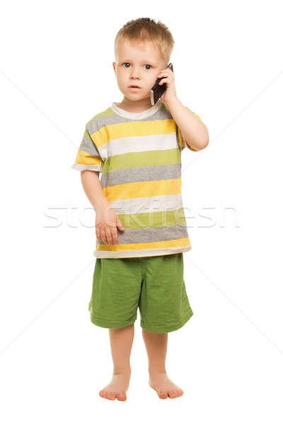 Pequeño nino shorts camiseta posando teléfono móvil Foto stock © acidgrey