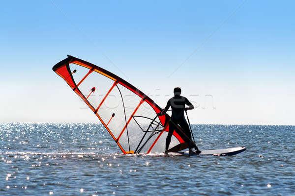 Windsurfer picks up the sail Stock photo © acidgrey