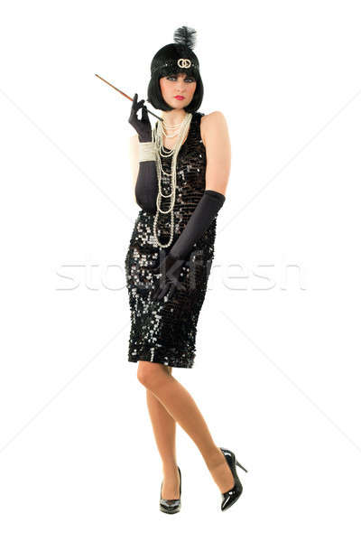 Young brunette with a cigarette holder Stock photo © acidgrey