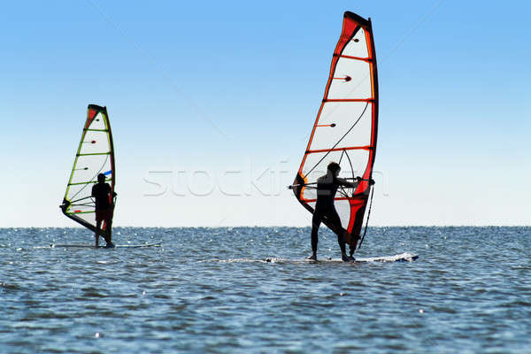 Silhouette of a two windsurfers Stock photo © acidgrey
