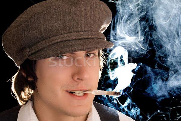 Roken man portret sluw glimlach geïsoleerd Stockfoto © acidgrey