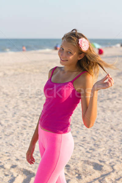 cheerful teen girl on the beach Stock photo © acidgrey